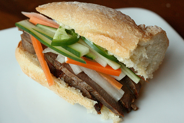Banh Mi - Thinly sliced sirloin goes a long way when sandwiched with pickled carrots in daikon in a banh mi.