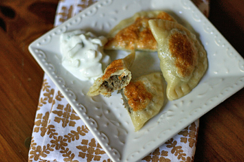 Pierogies - Lamb and potato pierogies are just the thing for dinner when fried and topped with a cucumber raita.