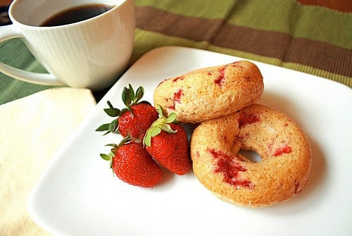Strawberry doughnuts are made with fresh berries and can be on your table in under 15 minutes! All you need is a doughnut pan and 10 ingredients.