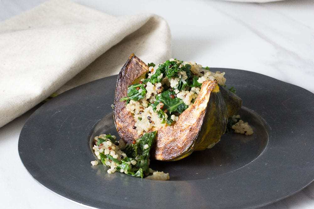 Kale and quinoa stuffed squash is a healthy side dish option for fall.