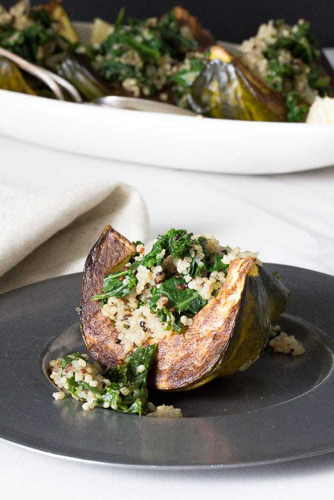 Kale and quinoa stuffed squash is an excellent side dish for Thanksgiving, or a simple meatless main.
