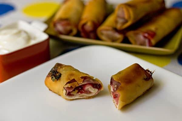 Fruit Eggrolls - Sweet cherries, raspberries, and apricots combine for a twist on Asian cuisine for these kid-friendly dessert fruit eggrolls.