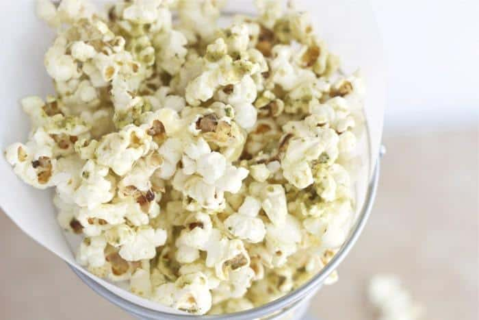 Pesto Popcorn is a great way to use up leftover pesto.