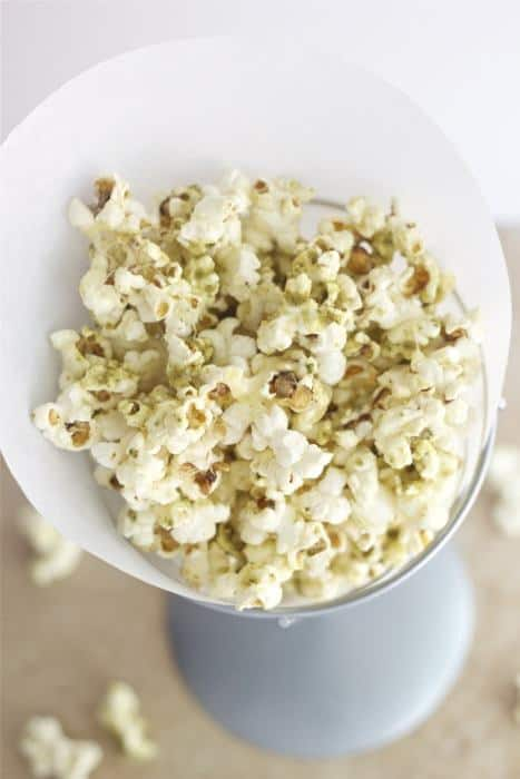 Pesto Popcorn - Have leftover pesto? Use it for this savory, summery pesto popcorn and snack away!