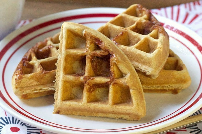 Peanut Butter and Jelly Waffles are great for eating as you rush out the door, or for packing into your picnic basket for later.