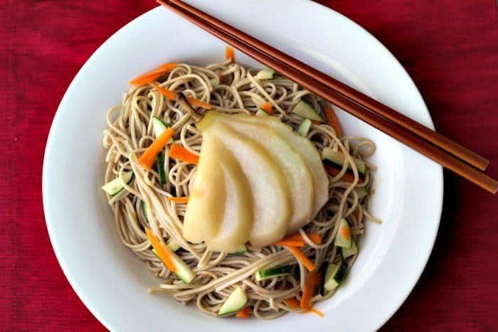 Poached Pears - Poached in tea and served with soba noodles, this dish is a creative way to use fall pears.