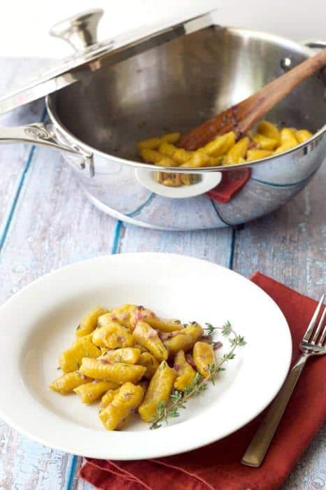 Pumpkin gnocchi is made even more decadent with a sauce of butter, shallots, bacon, and fresh herbs.