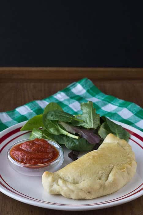 Pepperoni Calzones - Pour some syrup out for your Pawnee homies, and be sure to honor Leslie's OTP with pepperoni calzones.
