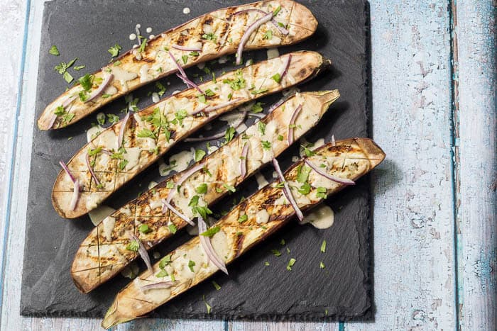 Grilled Eggplant with Tahini Sauce is a wonderful option for meatless meals.