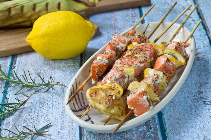 Salmon Kebabs are flavored with fresh herbs and lemon and easy to prepare for any night of the week.