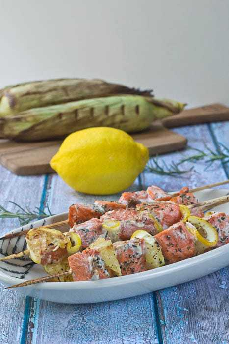 Salmon Kebabs are flavored with fresh lemon and herbs and are ready in a flash for a weeknight meal.
