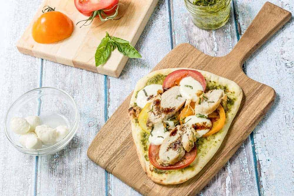 Caprese chicken flatbread turns a favorite summertime salad into a entree meal