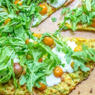 Got a glut of zucchini? Use it up in this crispy gluten free zucchini crust pizza, filled with fresh herbs!