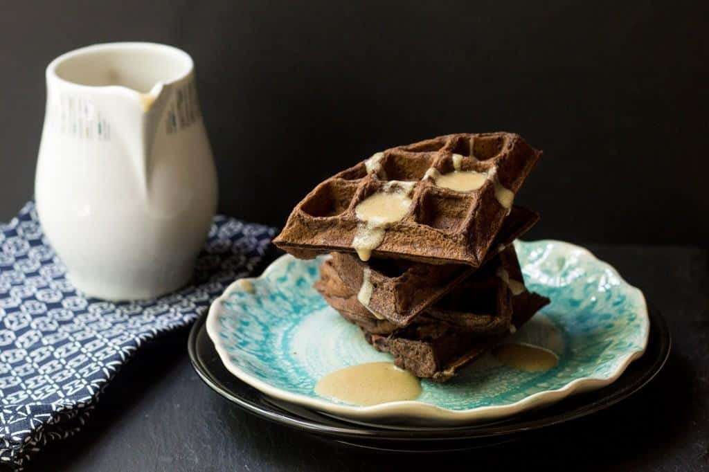 Chocolate Waffles with Whiskey Butter Sauce are perfect for a weekend indulgence.