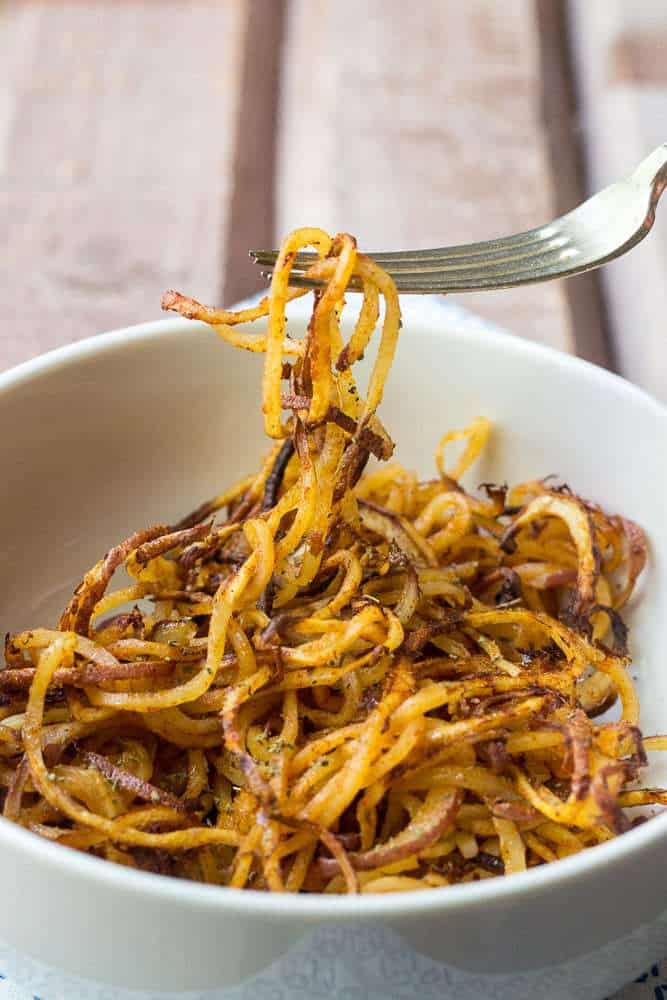 Spicy spiralized potatoes are a fun way to bring potatoes to the dinner table.