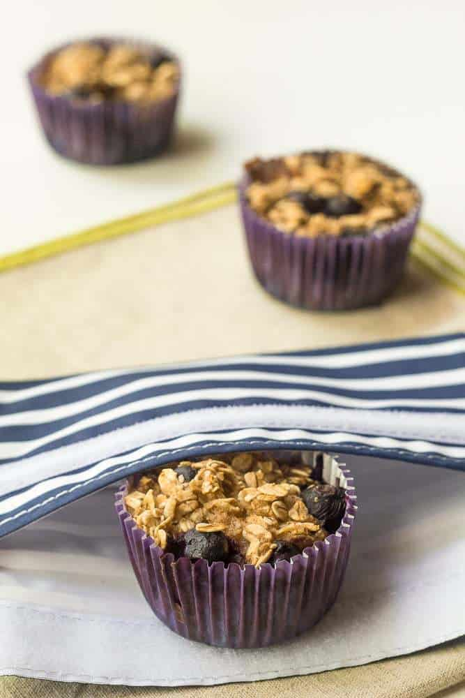 Baked Blueberry Oatmeal Cups - Make a batch of these baked blueberry oatmeal cups, and you'll have breakfast ready for the whole week.