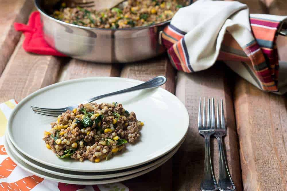 Bison One-Pot Dinner - Dinner is easy with this simple bison one-pot dinner, filled with harvest grains and wilted greens.