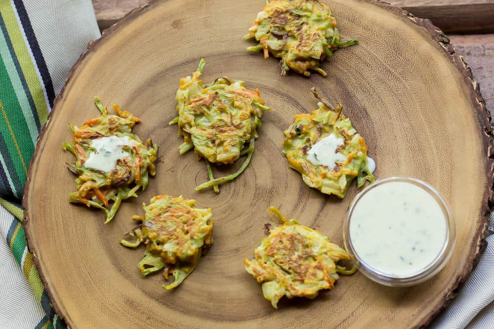 Mini vegetable latkes are a festive party-ready snack that are healthier than the traditional potato variety.