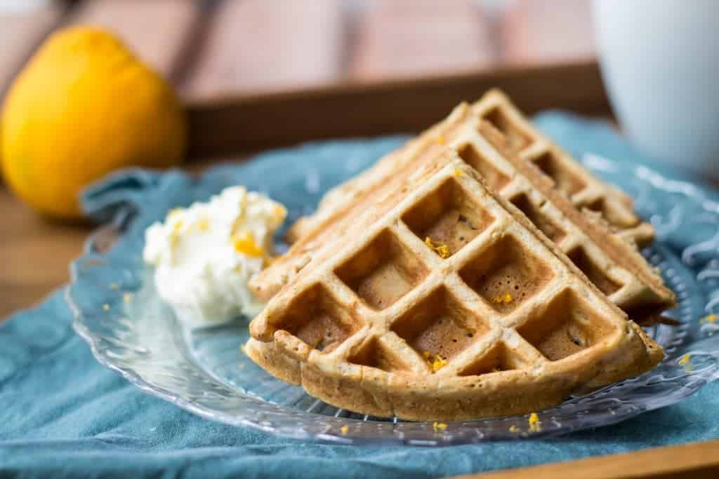 Orange spice waffles are full of warm spices and citrus flavor. They're easy to make for a cozy winter brunch.