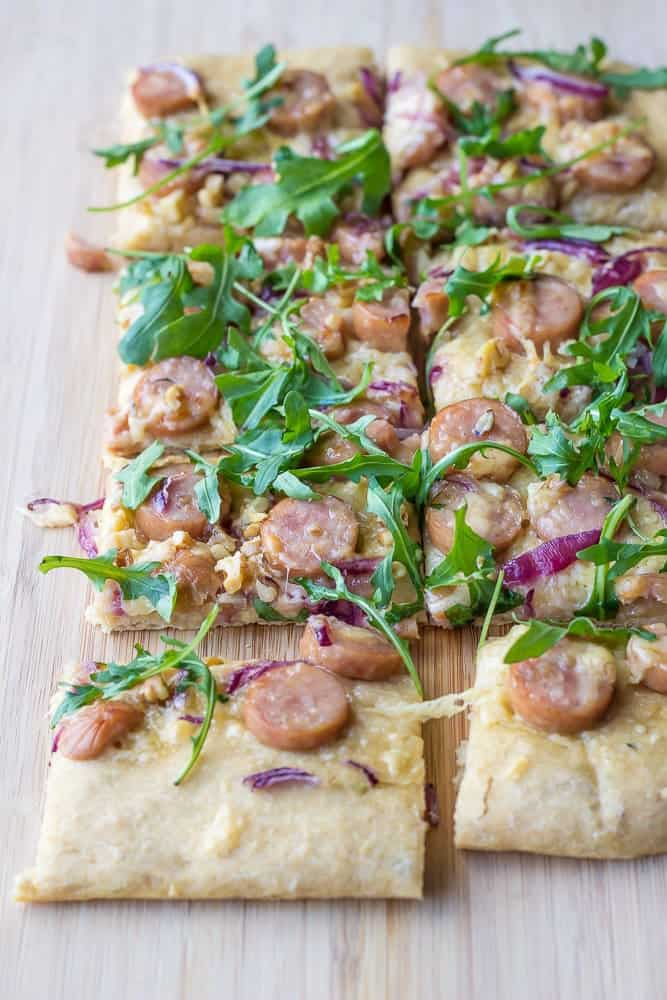Maple-walnut chicken sausage pizza is made with whole wheat dough and adds lots of flavor from arugula and just a drizzle of maple syrup.