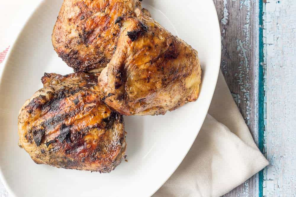 Rum jerk chicken using flavorful chicken thighs are a hit for your next cookout.