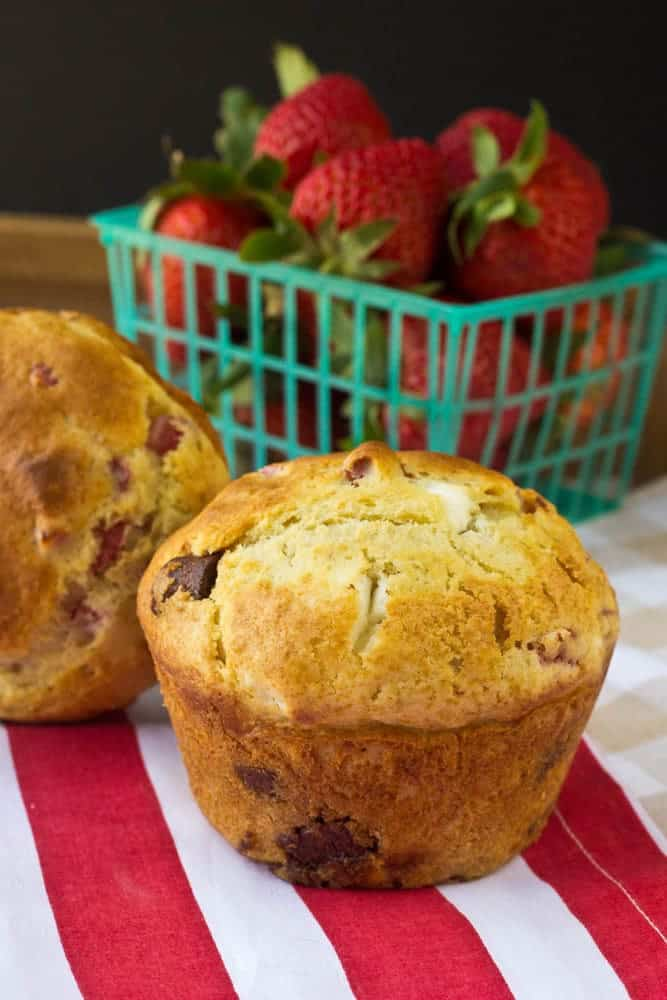 Strawberry cheesecake muffins are stuffed with milk chocolate, strawberries, and cream cheese for a dessert-worthy breakfast.