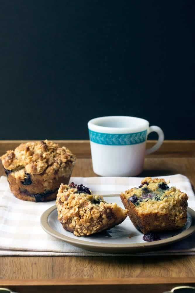 Blueberry streusel muffins are bursting with berries and topped with a crunchy oatmeal streusel.