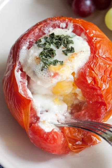 Baked eggs in tomatoes are a wonderful way to eat eggs in the summertime.