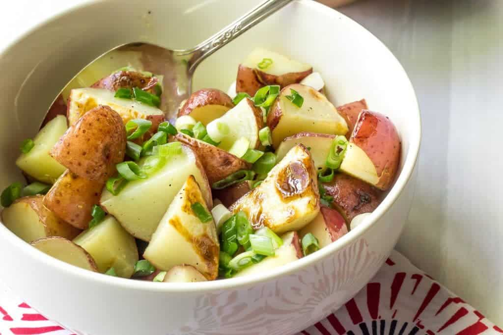 Lemony grilled potato salad is a bright side dish that is perfect for summer.