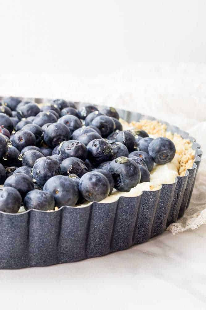 This blueberry white chocolate tart features a no-bake crust and luscious mascarpone cheese. It's perfect for the Fourth of July.