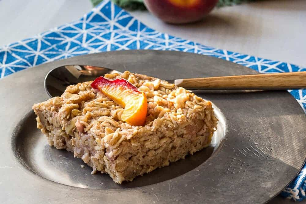 Baked peach oatmeal is easy to make to have on hand each morning. Just warm it up and you're ready to eat!