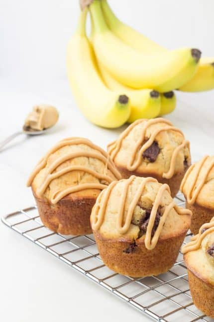 Chunky monkey muffins are a delicious morning treat. Filled with peanut butter, chocolate, and bananas, the whole family will love them!
