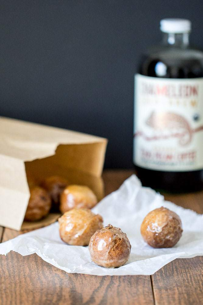 Pecan coffee donut holes are covered in a glaze made from cold-brew coffee. They're so light and fluffy!