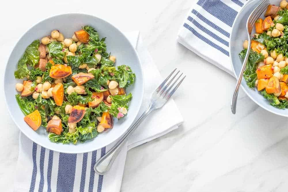 This roasted sweet potato salad wit chickpeas, kale, and a warm vinaigrette proves that salads aren't just for summer.