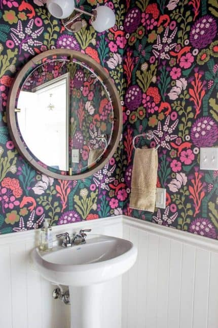 Add life to your home with powder room wallpaper. This vibrant floral paper is a hit!