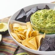 Roasted garlic guacamole is perfect for any party, any time of year.