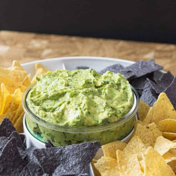 Roasted garlic guacamole is my go-to guacamole recipe! Why wait for Cinco de Mayo?