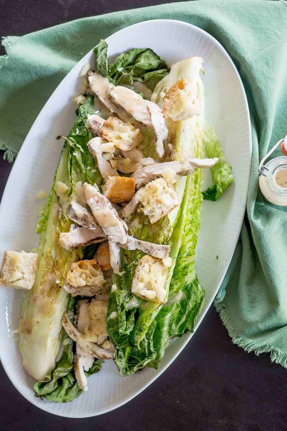 Grilled chicken Caesar salad is perfect for yourself, or for entertaining,