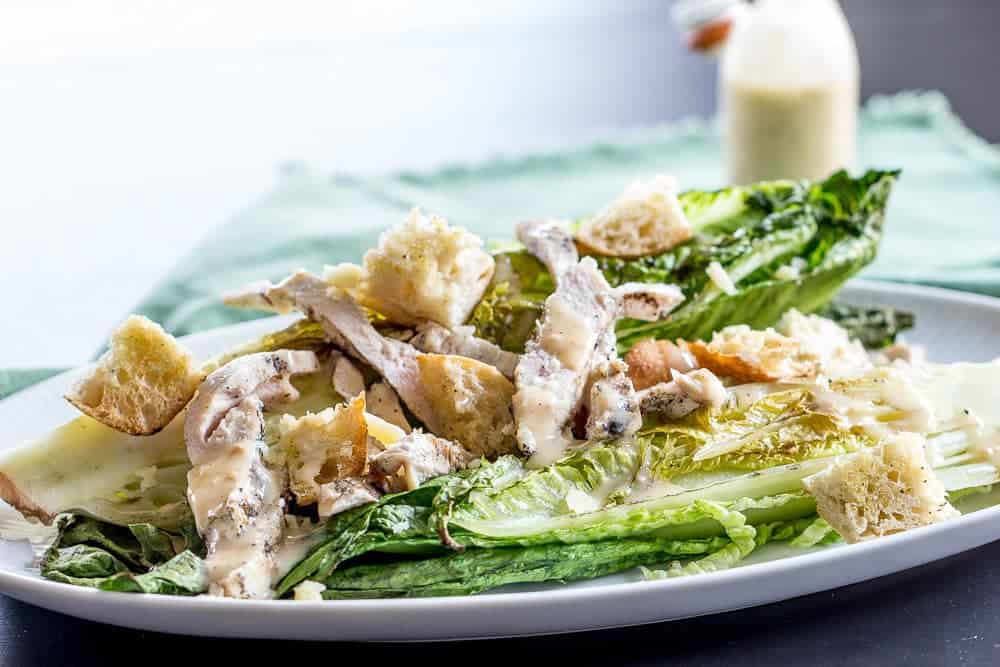 Grilled chicken Caesar salad cooks up on the grill in minutes. Even the lettuce is grilled!
