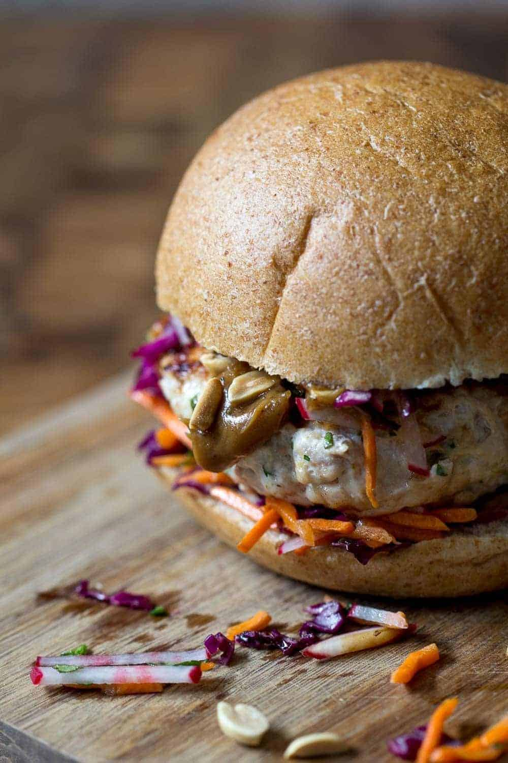 These Thai peanut chicken burgers add so much flair to dinner. Inspired by classic Thai flavors, it might be your new favorite burger!