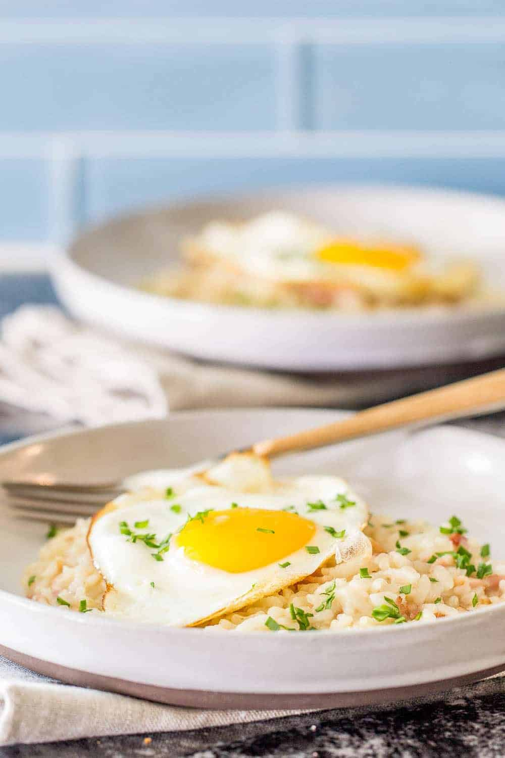 Bacon and egg risotto is made in the Instant Pot for an easy, savory breakfast.