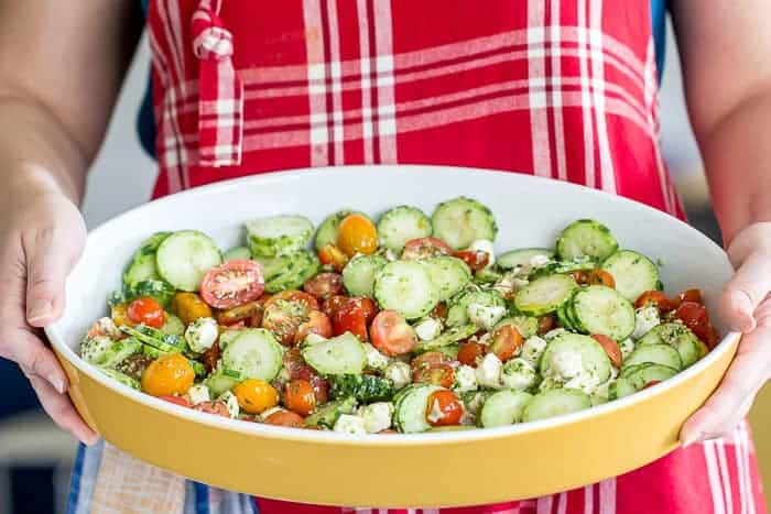 Cucumber tomato salad with pesto brings everything that is great about summer together in one dish. This no-cook dish is ideal for cookouts and potlucks.