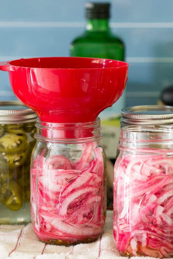 Pickled red onions are an essential topping for tacos, pulled pork, and hot dogs. They're easy to make to keep on hand all year long.