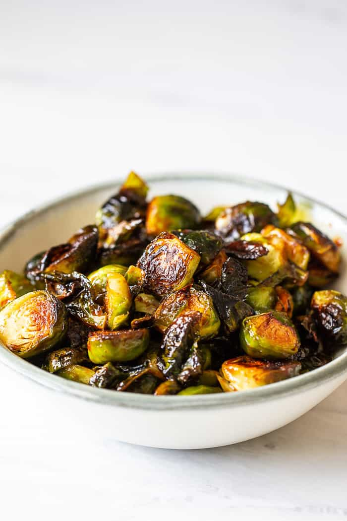 Spicy glazed brussels sprouts are a quick and easy side dish. It gets its flavor from the fiery Korean condiment, gochujang.