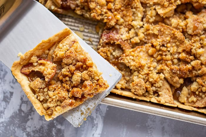 Caramel apple slab pie is a sweet finish for any gathering. Buy caramel sauce or make your own.