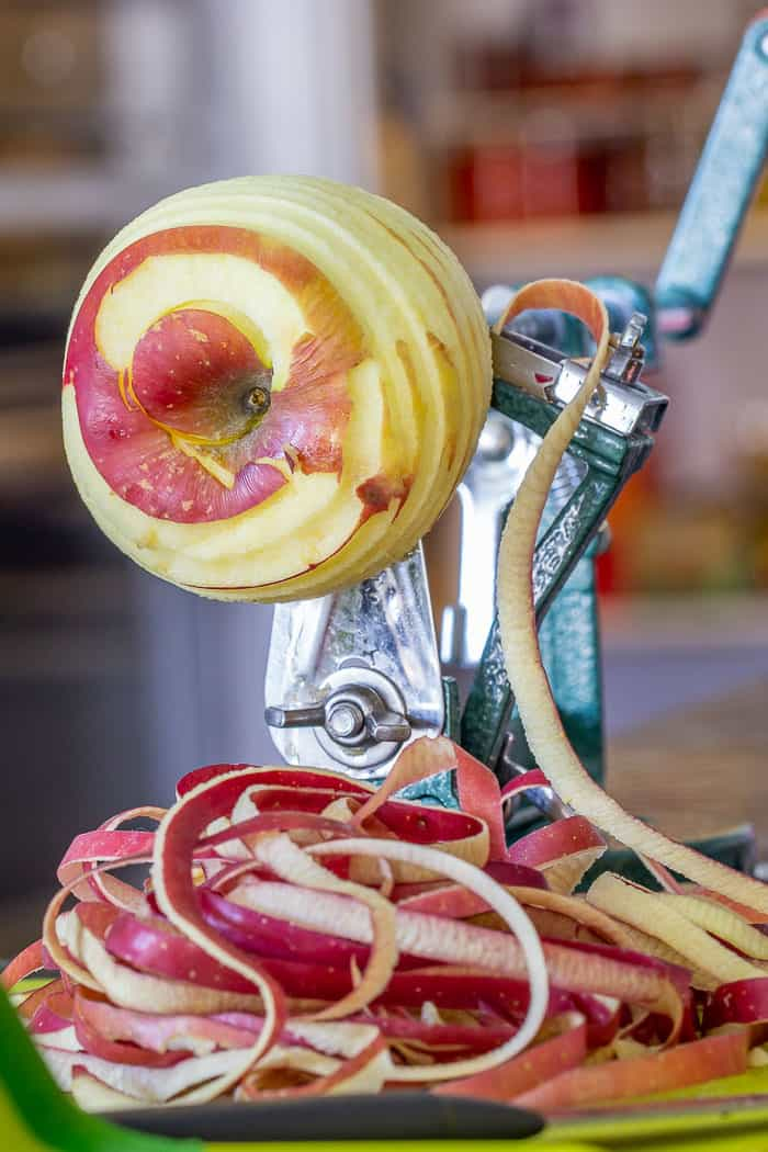 Peeling apples with an apple tool.