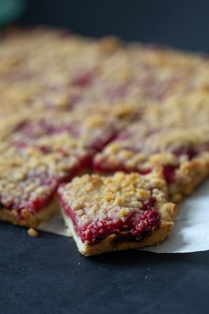 Raspberry pie bars sliced corner