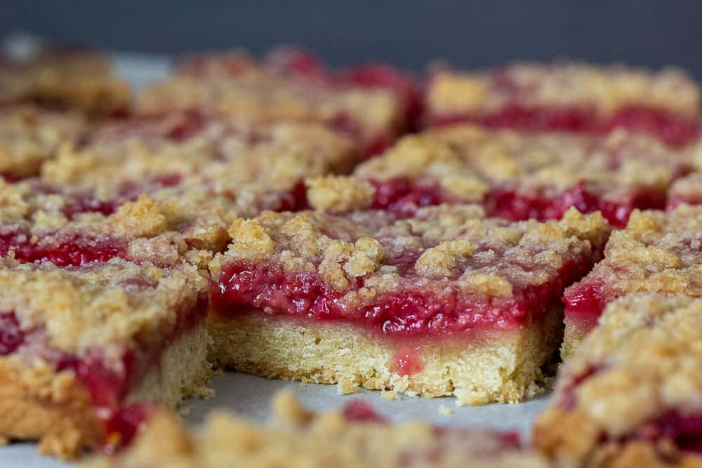 Sliced raspberry pie bars close up