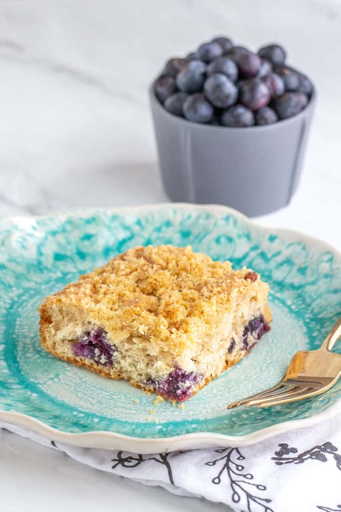 Blueberry coffee cake with blueberries in bowl