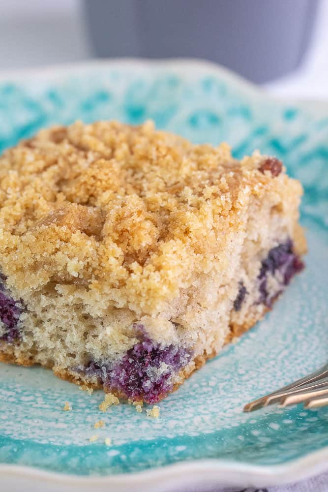 Blueberry coffee cake slice vertical